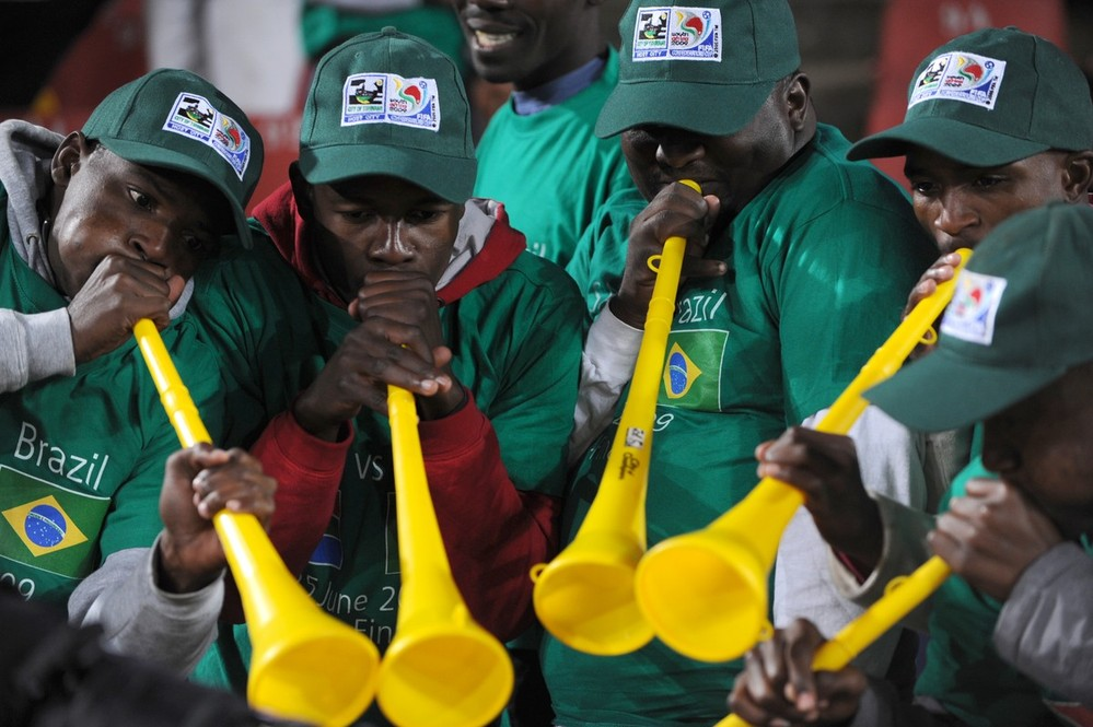 Supporters play the vuvuzela, large colo